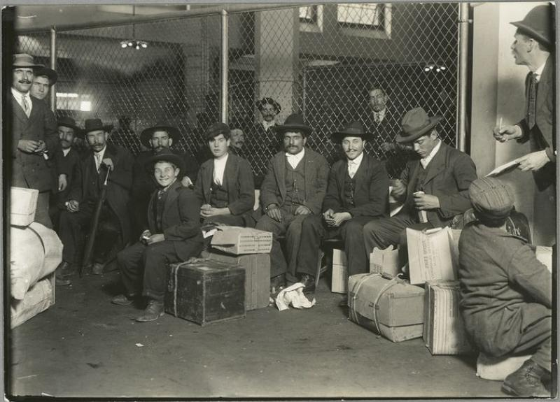 Group waiting at Ellis Island, NY Public Library Digital Collections