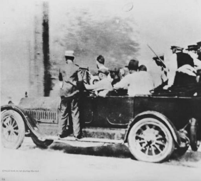 Unidentified Men in Cars with Guns during Race Riot